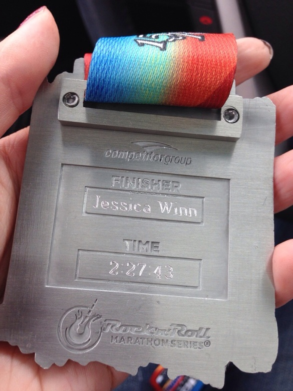 engraved medal from the country music half marathon