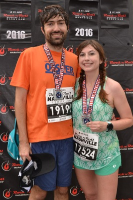 at the finish line of the 2016 rock n roll nashville half marathon